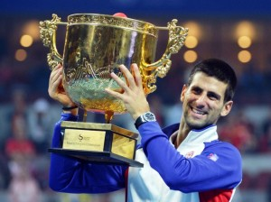 Novak Djokovic of Serbia poses with his trophy after beating Jo-Wilfried Tsonga of France in the men's singles final at the China Open tennis tournament in the National Tennis Center of Beijing on October 7, 2012.  Djokovic beat Tsonga 7-6, 6-2.      AFP PHOTO/Mark RALSTON