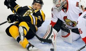 Ottawa Senators goaltender Robin Lehner makes a save in front of Boston Bruins' Patrice Bergeron