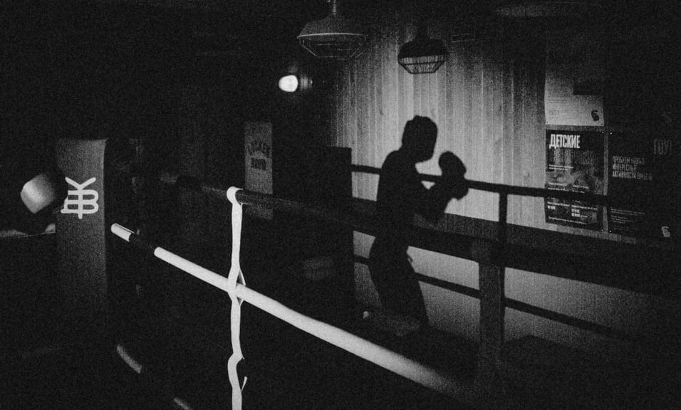 Shadow of boxer in boxing ring